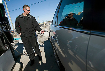 Record-Eagle/Jan-Michael Stump<br /> Frederick Freeman, of Traverse City, pumps gas at the Mutual Service Station on U.S. 31 on Friday afternoon.