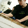 Record-Eagle/Lisa Perkins<br /> Traverse City Central High School Core Academy student Trevor Beehler is among the group that spends several hours each week working on the restoration of a 23 foot Lyman wooden watercraft from 1950.