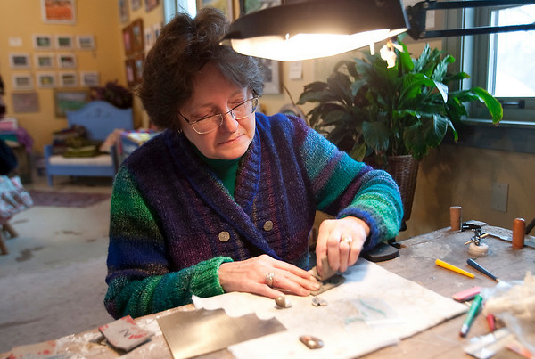 Record-Eagle/Douglas Tesner<br /> Artisan Liz Saile works on a turquoise pendant and earrings in L.Saile, her shop in Cedar.