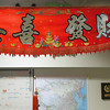 "Record-Eagle/Keith King<br /> A banner that reads ""congratulations, may you prosper"" in Chinese is displayed at the White Tiger Martial Arts studio."