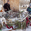 Record-Eagle/Keith King<br /> Kylie Korienek, 10, of Traverse City, and artist Bill Allen, of Leelanau County, arrange sticks, branches and fabric. The hope is that birds will use the wood and fabric to make their nests.