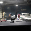 Record-Eagle/Jan-Michael Stump<br /> Mechanic Tom Dunn, left, and Tom Chester, a student worker on the line crew for the Northwestern Michigan College aviation program, give a plane its 100-hour inspection in a hanger. The college is exploring exchange programs with a Chinese group.