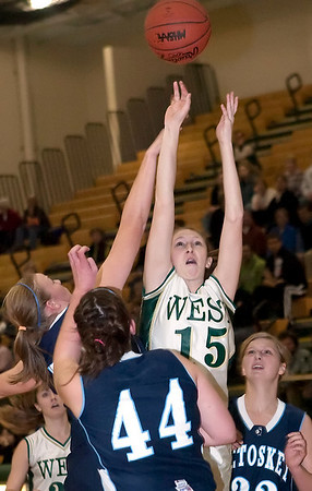Record-Eagle/Douglas Tesner<br /> Traverse City West's Shaina Streeter (115) shoots over the Petoskey defense, including Kerby Tamm (44) and Katelyn Crittenden in West's 57-26 victory Friday.
