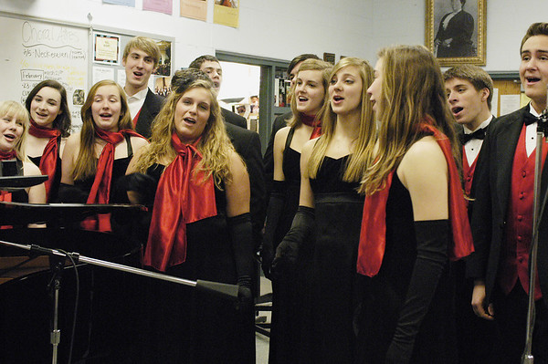 Record-Eagle/Lisa Perkins<br /> Members of Traverse City Central High School's Choral-Aires a capella ensemble rehearse for this weekend's Singing Valentine fundraiser.