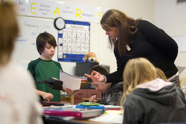 Record-Eagle/Jan-Michael Stump<br /> Buckley sixth grade teacher Sarah Jane Miller helps Austin Burt with a question in class on Wednesday.