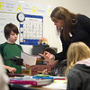 Record-Eagle/Jan-Michael Stump<br /> Buckley sixth grade teacher Sarah Jane Miller helps Austin Burt with a question in class on Wednesday.