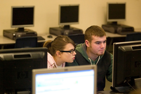 Record-Eagle/Jan-Michael Stump<br /> Buckley junior Mariah Grzybowski and senior Sam Porter work on a business writing class project in the school's media center.