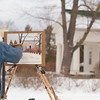 "Record-Eagle/Jan-Michael Stump<br /> William Hosner, of Traverse City, uses pastels to paint a house on Boardman Avenue. Hosner had been working for a couple of hours, but planned to break for the day to warm his hands. ""When you first get out here they hurt like crazy,"" he said. ""But you know, after a while, they get used to it."""