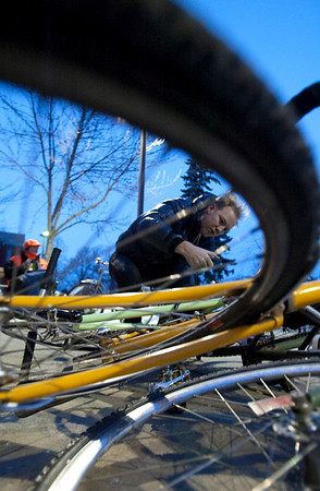 Record-Eagle/Douglas Tesner<br /> Carl Bean-Larson padlocks his bike to others before entering a city commission study session at the Governmental Center in Traverse City.