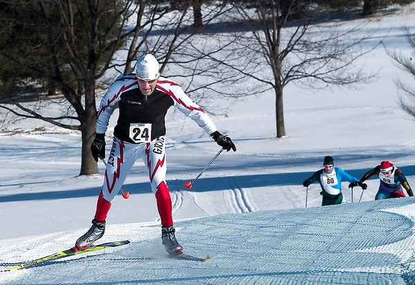 Record-Eagle/Douglas Tesner<br /> Peter D'Arienzo, of Paw Paw, heads toward the finish with Jon Morgan, of Milford, and Tim Onthank, of Traverse City, in pursuit during the 40K Race. More then 150 skiers participated in the race, while other skiers took part in 10K and 20K races.