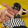 Record-Eagle/James Cook<br /> Traverse City Central heavyweight Cody Vickers, top, works on a pinfall against Traverse City West's Cody Thomas. TC Central won the dual 36-28 in the Division 1 district semifinal, but later fell to Rockford.