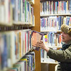 Record-Eagle/Jan-Michael Stump<br /> Andrew Bonner, of Interlochen, browses through science fiction books at the Interlochen Public Library.
