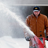 "Record-Eagle/Douglas Tesner<br /> Scott Lindstrom takes advantage of the break in the weather to blow snow in his driveway on Hobbes Highway. ""I have done it so many times,"" he said."