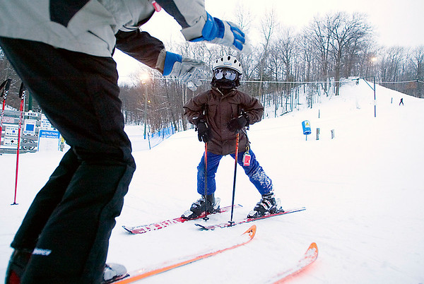 Record-Eagle/Jan-Michael Stump<br /> Max Ranger gets instruction on his technique from Grand Traverse Ski Club coach Chris Bornschein during a clinic at Hickory Hills.