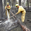 Record-Eagle file photo/Douglas Tesner<br /> Firefighters work to extinguish remnants of the massive<br /> wildfire in April 2008 near Grayling.