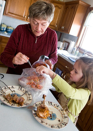 Record-Eagle/Douglas Tesner<br /> Dorothy Wonacott and granddaughter Alexa Wonacott prepare a meal called Turkey Leg in a bag. Dorothy is a widow who cooks for one and also frequently makes large meals for family.