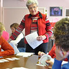 Record-Eagle/Vanessa McCray<br /> Bridge instructor Shirley Delaney, standing in center, shares pointers with card players Judy VanDeWeghe, left, and Sherri Freels, far right, during a lesson at the Traverse City Senior Center. Delaney has taught bridge for 17 years.