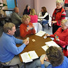 Record-Eagle/Vanessa McCray<br /> Bridge instructor Shirley Delaney, standing at right, fielded questions about the complex card game from two tables of players during a lesson at the Traverse City Senior Center.