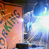 Record-Eagle/Garret Leiva<br /> Milt Gere, of Dewitt, Mich., welds up pieces of a gas forge project Saturday at the Folly at the Forge held at Black Rock Forge in Traverse City.