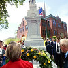 Record-Eagle/Douglas Tesner<br /> A crowd gathers around the restored Civil War Soldier Monument on the Grand Traverse County Courthouse lawn for its Memorial Day  rededication on May 30, 2005, 115 years after its original dedication.