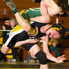 Record-Eagle/Jan-Michael Stump<br /> Traverse City Central 103-pounder Connor Kerndt defeated Midland Dow's Ryan Hill.