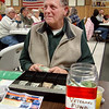 Record-Eagle/Marta Hepler Drahos<br /> Bob Meyer sells meal tickets during a fish fry at American Legion Post 219 in Fife Lake.