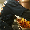 Record-Eagle/Marta Hepler Drahos<br /> Ed Hodges fries Icelandic cod during an American Legion Post 219 fish fry.