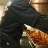 Record-Eagle/Marta Hepler Drahos<br /> Ed Hodges fries Icelandic cod during an American Legion Post 219 fish fry.