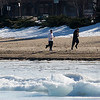 "Record-Eagle/Douglas Tesner<br /> John Franttie, left, and Tyler Munroe take advantage of sprint-like weather and enjoy a run down Clinch Park Beach in Traverse City.  Both are students at Northwestern Michigan College.  ""It is really a beautiful day out,"" said Franttie."