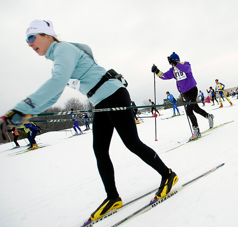 Record-Eagle/Jan-Michael Stump<br /> Skiers start the 40k White Pine Stampede cross country ski race Saturday morning at Mancelona High School.