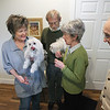 Record-Eagle/Keith King<br /> Marsha and Bob Siegle, left, of Traverse City, hold their dogs as they stand with Marsha's parents, Rita and Stewart, in the entryway that both couples share.