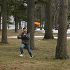 "Record-Eagle/Keith King<br /> Zach Morgan, of Traverse City, runs to catch a flying disc. ""We had to get out, it's beautiful out here,"" Morgan said."