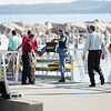 Record-Eagle file photo/Jan-Michael Stump<br /> Officials investigate the scene where 18 year-old Mancelona resident Michael Knudsen drowned while swimming off of Dock F in Clinch Marina last August.
