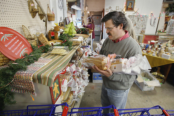 Record-Eagle/Keith King<br /> Volunteer Don Bates arranges loaves of bread, which were delivered by Food Rescue of Northwest Michigan, onto shelves at the St. Vincent de Paul thrift store in Traverse City.
