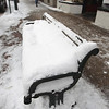 Record-Eagle/Keith King<br /> Snow lies on a bench along Front Street in downtown Traverse City.