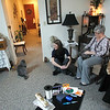Record-Eagle/Jan-Michael Stump<br /> Dr. Mindy Cooper, left, visits with Grand Traverse Pavillions' Hawthorne Cottage resident Nancy Wolpert and her cats, Lily, left, and Abby, right. Cooper visits residents with pets to ensure access to veterinary care.