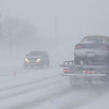 Record-Eagle/Keith King<br /> Traffic moves along Grandview Parkway in Traverse City on Monday in blizzard conditions.