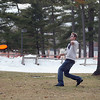 "Record-Eagle/Keith King<br /> Arik Zaleski, of Traverse City, throws a flying disc as he plays with friends  in the mild temperatures Friday at the Grand Traverse County Civic Center. ""I'm never over this game, especially when it's nice out,"" Zaleski said."
