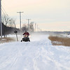 Record-Eagle/Keith King<br /> Snowmobilers travel near U.S. 131 in Chestonia Township.