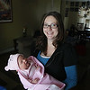 Record-Eagle/Keith King<br /> Olivia Marie Griffore is held by her mother, Jenny Griffore, of Mancelona, after being born January 1, 2012 at Munson Medical Center.
