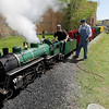 Record-Eagle file photo/Keith King<br /> Tucker Bailey, left, and Don Frost tune up the Spirit of Traverse City train at Clinch Park.