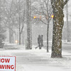 Record-Eagle/Vanessa McCray<br /> Pedestrians walk near the corner of Ninth and Cass streets in Traverse City on Sunday, where wet roads were made slick by the start of a lake-effect snow storm.