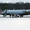 Record-Eagle/Douglas Tesner<br /> Passengers of United Express flight 6036 from Chicago stand on the tarmac at Cherry Capital Airport Friday after reports that a suspicious person was aboard the plane.