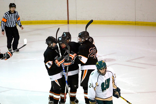 Record-Eagle/Jan-Michael Stump<br /> Traverse City West's Nick VandeKieft skates away as Brother Rice players celebrate a goal by defenseman Jon Van Antwerp (26) to go up 3-1 in the second period.