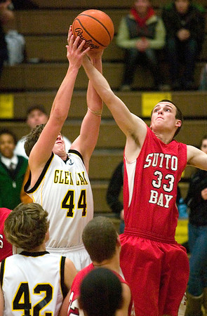 Record-Eagle/Jan-Michael Stump<br /> Suttons Bay's Stephen Wheelock (33) and Glen Lake's Dan Kornelius fight for a rebound in the second half of Thursday's game.