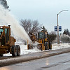 Record-Eagle/Douglas Tesner<br /> Heavy equipment moves down Grandview Parkway as Traverse City Sreet Department workers clean up the remaining snow.