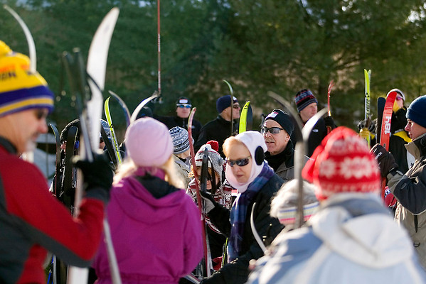 Record-Eagle/Jan-Michael Stump<br /> People gather for cross-country ski lessons taught by members of the Vasa Ski Club at Saturday's  Winter Trails Day at the Vasa Pathway Trailhead in Acme. More than 100 people came for lessons in cross-country skiing and snowshoeing.