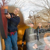 Record-Eagle/Jan-Michael Stump<br /> George Powell hangs a piece of art in the window of The Artisan Design Network, a cooperative of local artists and craftsmen opening on Front Street in downtown Traverse City.