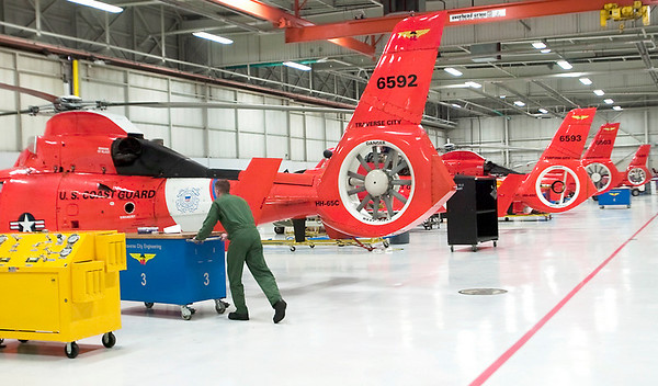 Record-Eagle/Douglas Tesner<br /> A technician works at the air station in Traverse City. The city is up for approval as the 10th Coast Guard city in the nation and the second in Michigan.