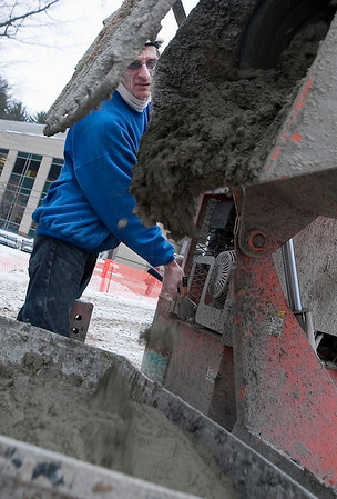 Record-Eagle/Douglas Tesner<br /> Heath Holcomb, a mason working for Grand Traverse Construction, pours mortar he mixed for bricks to be used on West Hall at Northwestern Michigan College in Traverse City.